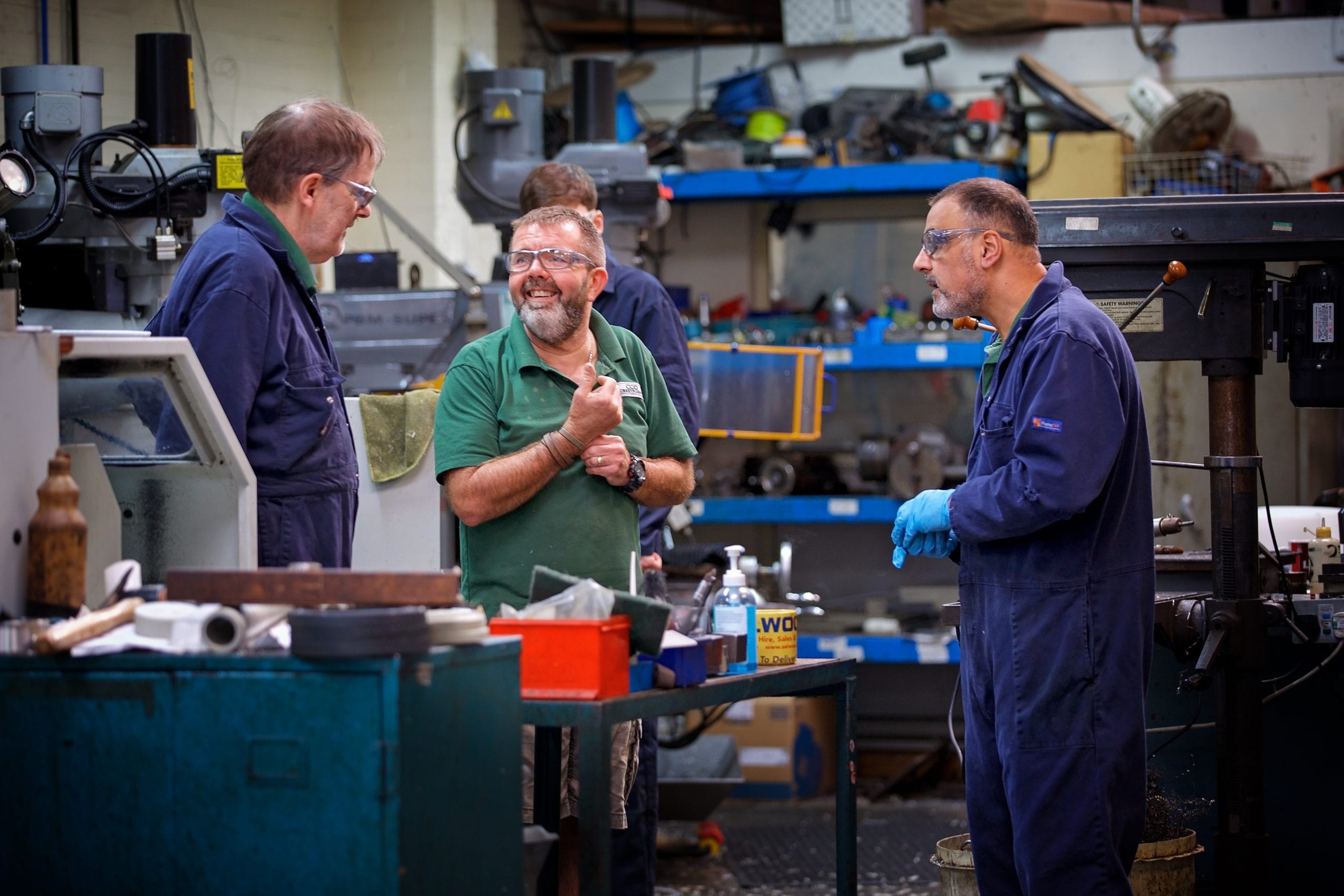 The pump manufacturing team smiling and having a meeting in the workshop
